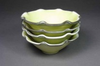 Yellow porcelain fluted bowls with gray rims.
