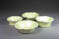 Yellow porcelain fluted dessert bowls.