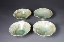 Fluted green porcelain bowls with brown highlights.