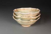 Green porcelain fluted bowl stack.