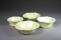 Yellow porcelain fluted dessert bowls.